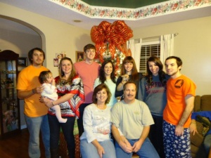 Sandra and Ken with their children and granddaughter.